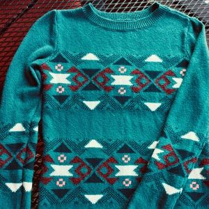 Pullover sweater.  Green with Aztec design.